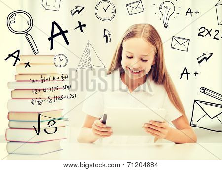 education, school, technology and internet concept - little student girl with tablet pc and books at school