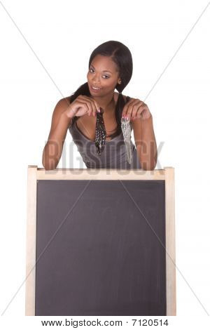 African-american Woman With Condoms By Blackboard