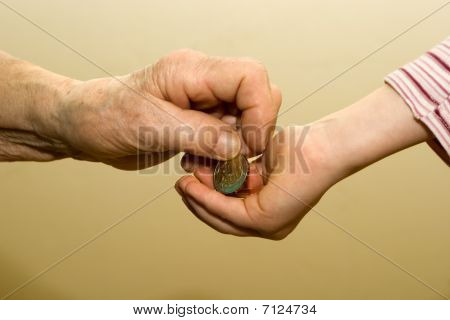 earnings of old woman and hand of granchild