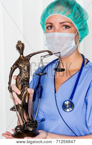 a nurse or doctor in surgical clothes before surgery. symbol photo for work in the hospital poster
