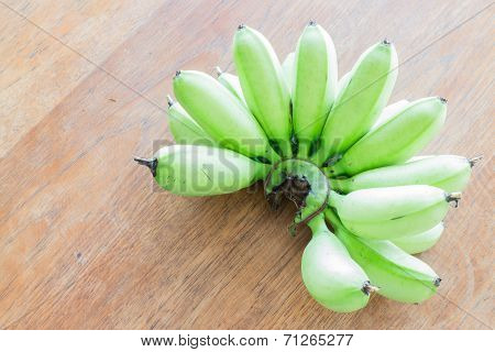 Raw Banana Bunch On Wooden Table