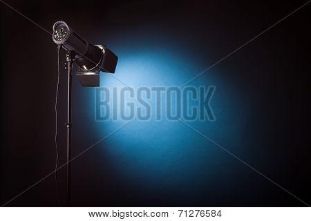 Studio light shines on dark background