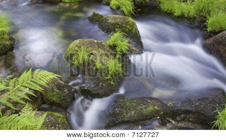 Beautiful waterfall on the Portuguese mountain river poster