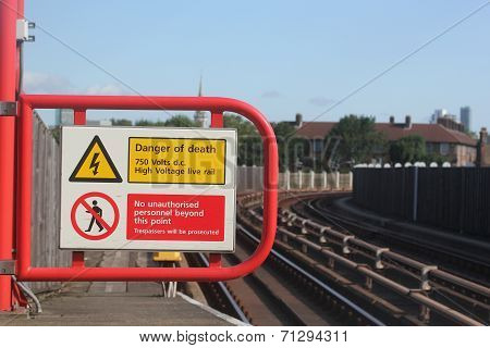 Electric Shock Hazard No Entry Or Trespassing Sign Near Rail Or Train Station