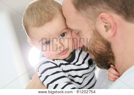 Portrait of daddy embracing baby boy poster