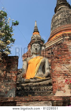 Buddha In Front Of Giant Pagoda At Watyaichaimongkol Temple In Ayudhaya, Thailand