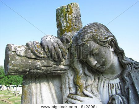 Angel Leans on Cross
