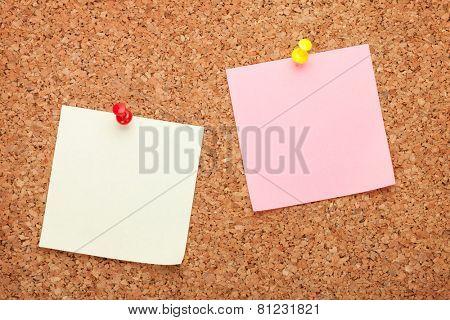 Blank postit notes on cork wood notice board