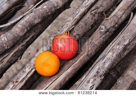 Orange and Pomegranate placed on very old casuarina try wood