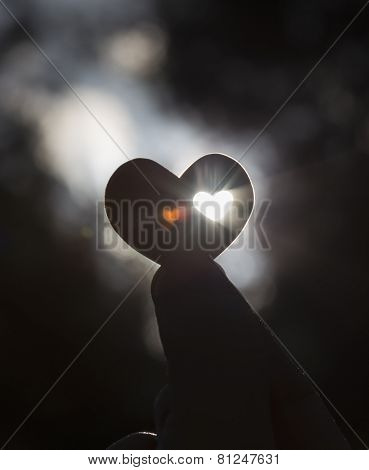 Heart Shape Against The Sun With Heart Ghost Shape