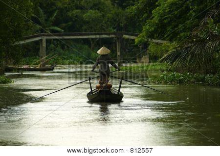 Woman on a boat in Vietnam