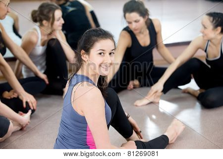Group Of Happy Sporty Young Women Chatting On Break In Sports Gym