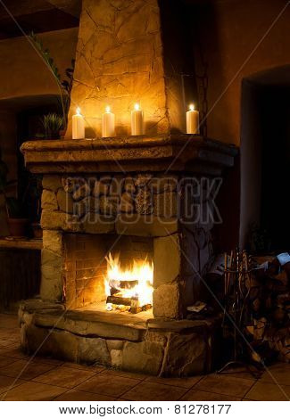 Fireplace Room. Chimney, Candles And Woodpile. Classic Interior. Chimney Place. Vintage Style.