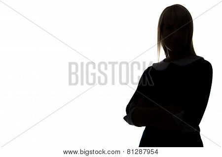 Silhouette of woman with arms crossed, half-turned