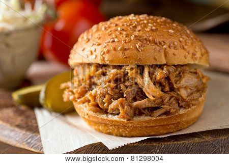 A delicious slow roasted pulled pork sandwich on a Texas style bun. poster