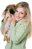 Young cheerful blonde with a puppy. Isolated on white poster