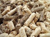 wood pellets for fireplaces and stoves (close up) poster