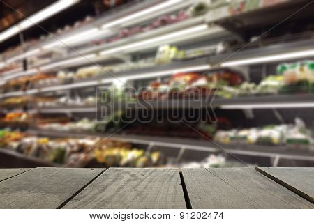 Defocus And Blur Image Of Terrace Wood And Supermarket Blur Back