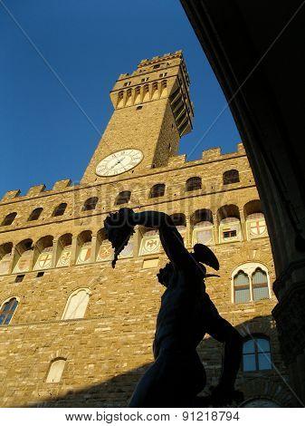 Florence, Italy. Palazzo vecchio and Benvenuto Cellini statue