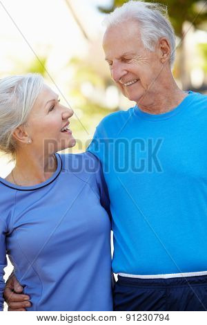 Elderly man and younger woman outdoors