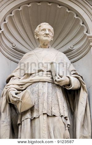Historic statue of Cardinal John Henry Newman.  Due to be beatified by the Pope - a route to sainthood - on Sunday 19th September, Cardinal Newman converted from Anglicanism to Catholicism. poster