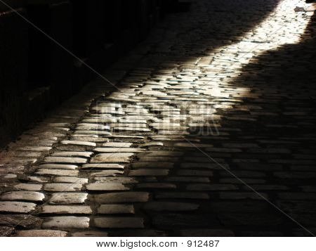 Cobblestones And Sunset