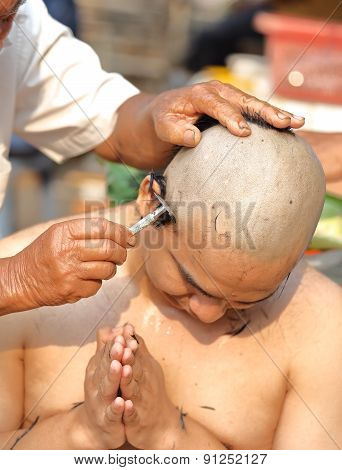 Male who will be monk shaving hair for be Ordained to new monk poster