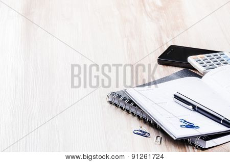 Business Concept With Agenda, Mobile Phone And Calculator