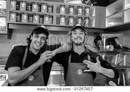 LOS ANGELES - APRIL 14: barmen in Starbucks Cafe on April 14, 2011 in Los Angeles, USA. Starbucks is the largest coffeehouse company in the world, with 23,187 stores