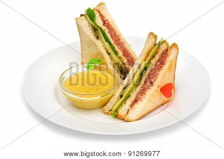Club sandwiches with dip sauce on the plate