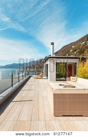 modern architecture, beautiful lake view from the terrace of a penthouse