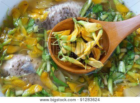 Vietnamese food sour fish vegetable soup ingredients as fish pineapple tamarind coriander common sesban or bong dien dien this nutrition eating is specific of Mekong Delta Vietnam on summer poster