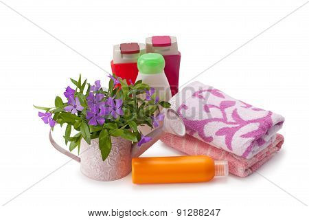 towels and shampoo isolated on white background poster
