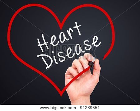 Man Hand writing Heart Disease with marker on transparent wipe board.