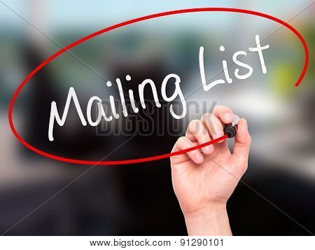 Man Hand writing Mailing List with marker on transparent wipe board.
