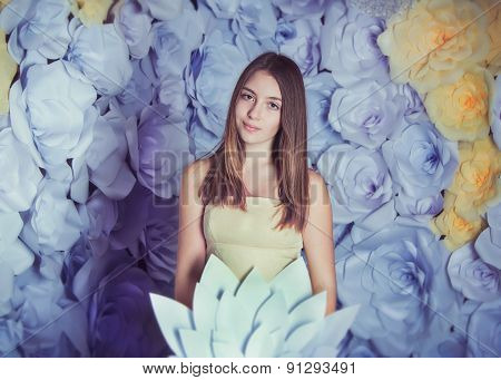 Teen girl with paper flower