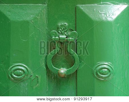 A metal ring as a door knocker