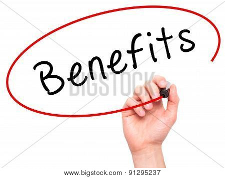 Man Hand writing Benefits with marker on transparent wipe board.