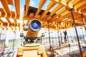 Surveyor equipment level theodolite outdoors at construction site poster