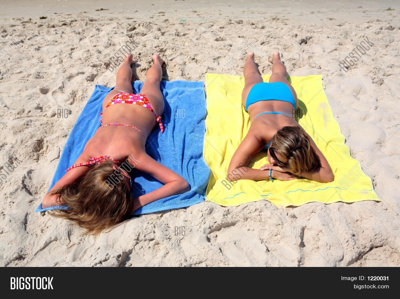 On the beach teens laying