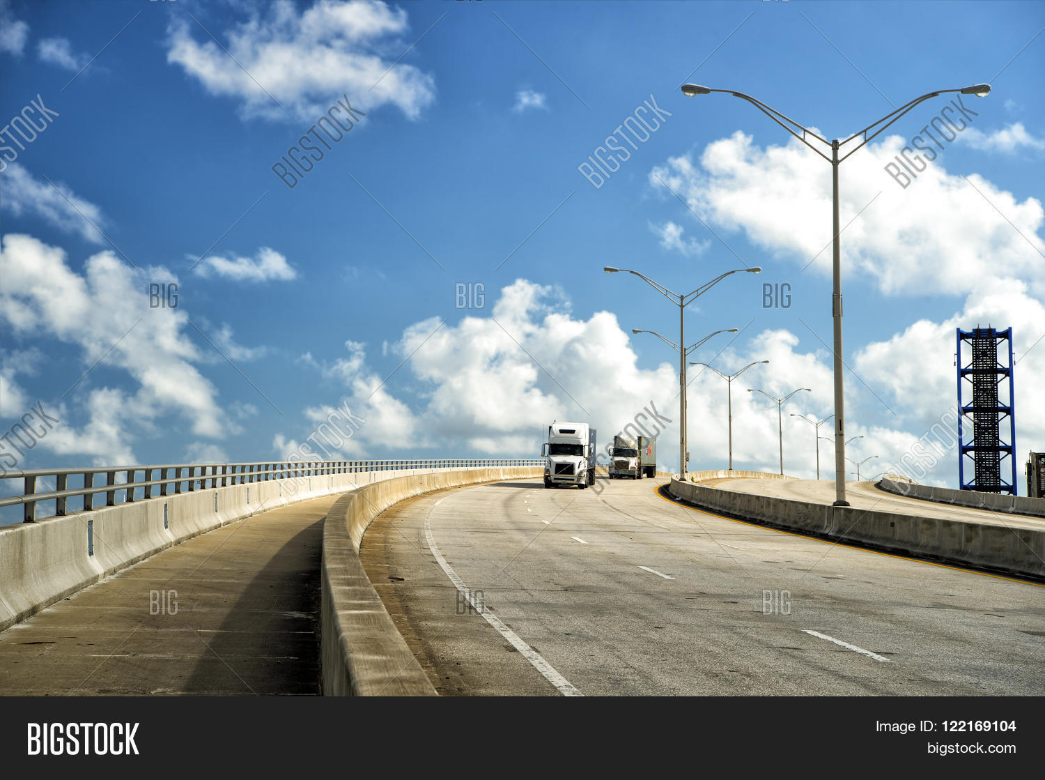 View On Highway Road With Two Transit Lorry Street Lamps Outdoor Sunny Weather Cloudy Blue