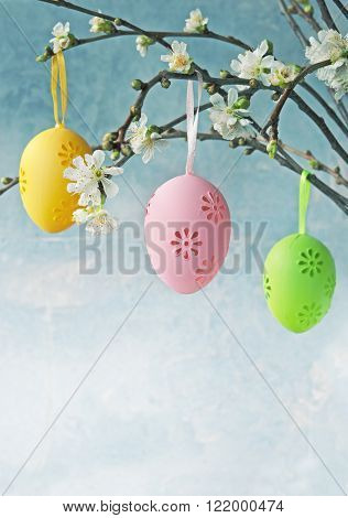 Easter colorful eggs hanging at a blooming branch