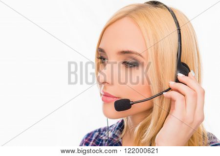 Young Minded Pretty Woman In Headphones Touching Microphone
