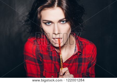 Pretty Young Female Model Eating Tasty Candy