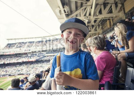 Young boy enjoying a day watching a professional baseball game