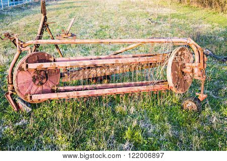 Old Rusty Farmers Tiller in Empty Field