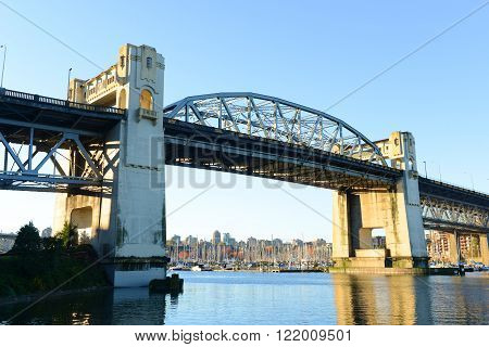 Vancouver Burrard Bridge is an Art Deco style bridge crossing False Creek between downtown Vancouver and Kitsilano, British Columbia, Canada.