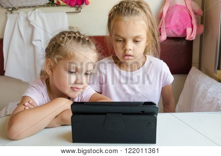 Two Girls Looking At The Tablet In The Train