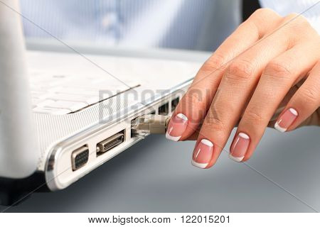 Female hand inserting lan cable. Lady's hand inserts lan cable. Let's surf the internet. Time to download new software.