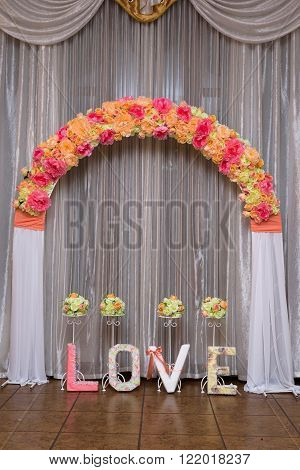 beautiful arch from colors and inscription love dekor